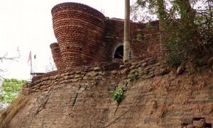 Semi-finished modern red-brick structure being raised inside Chadi-gurh
