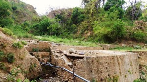 The damaged stone embankment