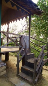 Quaint wooden staircase to the elevated platform of a eco-hut, Nature Camp Thapli